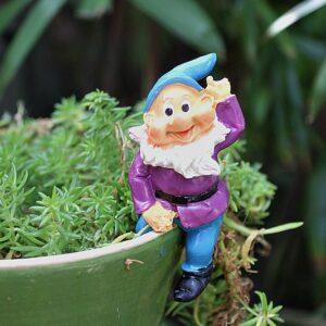 pixie sitting on a garden pot, garden gnome